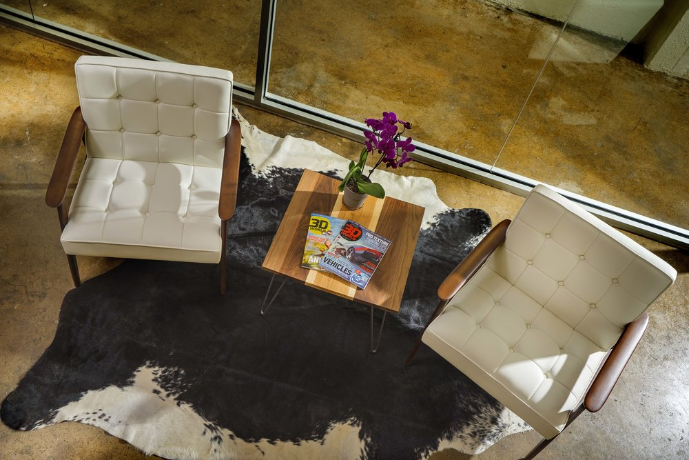 Reception_Chairs_Cowhide_Rug_Interior_Design_Lauderdale_Design_Group_Knoxville.jpg