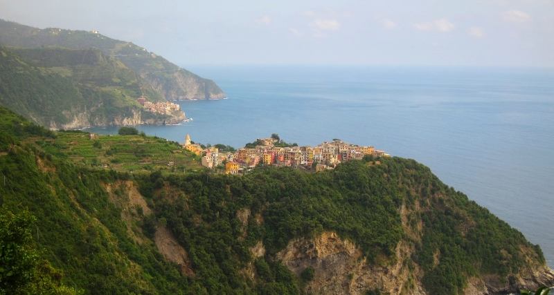 Hike from Corniglia to Vernazza. There is a viewpoint where you can see Corniglia and Manarola! Beautiful spot in Cinque Terre. See more at www.femalehiker.com