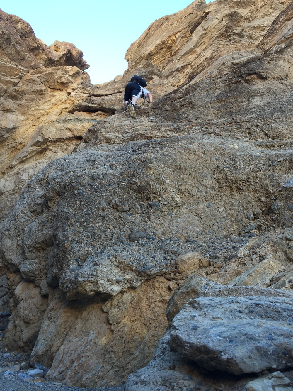 Scrambling up  at Mosaic Canyon in Death Valley.