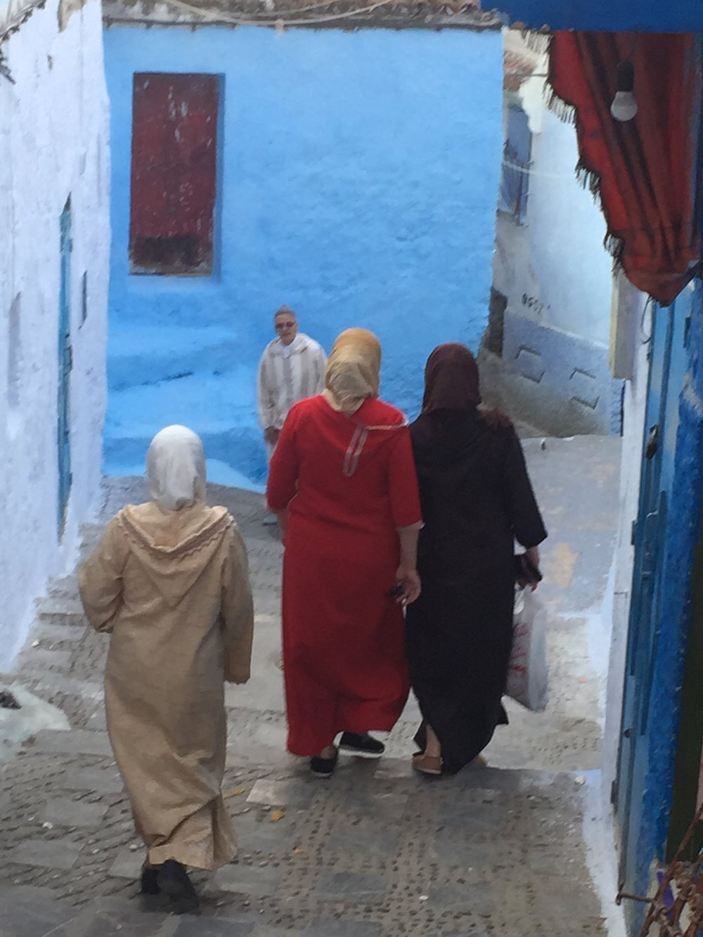 Moroccan women taking a stroll thru Chefchaouen, the Blue City