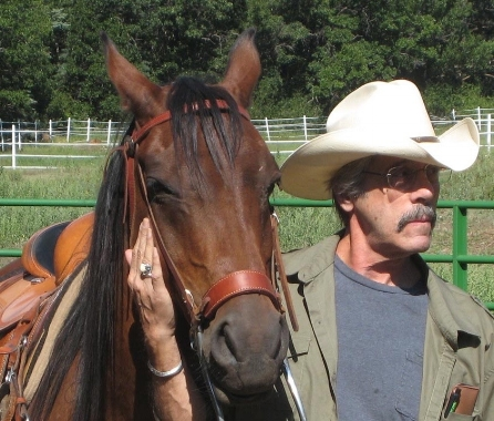Gerry, wearing Jim's hat at our place in Sapello, New Mexico, sharing an insightful moment with his best friend George the Gelding.