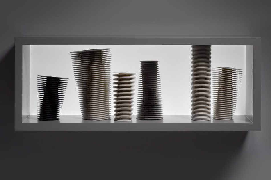 Group of Leaning Vessels in a Lightbox, 2016  Parian Porcelain and Black Porcelain, 30 H x 80 W x 20 D cm