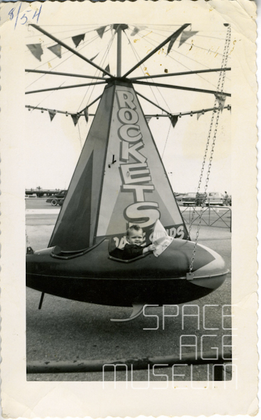 Little Boy in Rocket Carnival Ride (Ride manufactured by Murdock 1954)