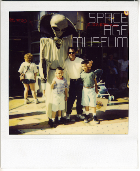 "Father and Sons in front of ""Things From Another World"" Store (circa 1992)"