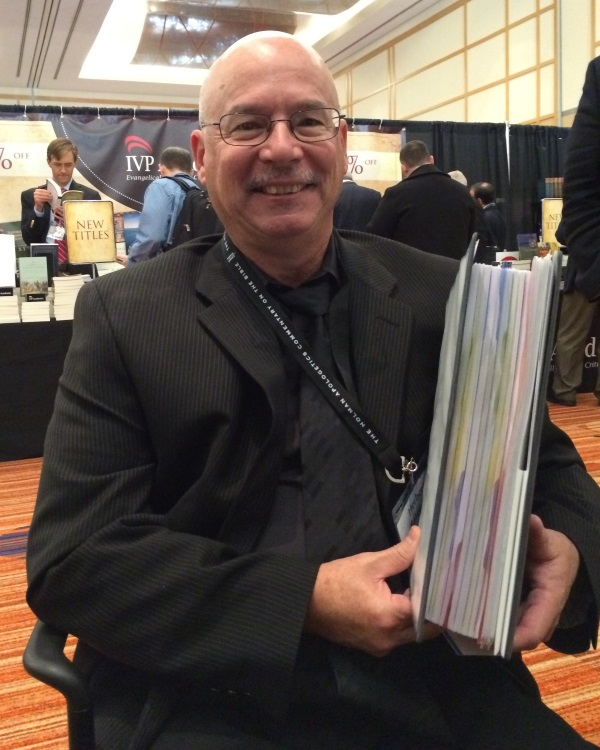 Herb Bateman with the manuscript for his volume on Jude