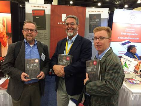 Michael Bird (on the right), along with Michael Horton and Scott Hahn, all holding Vos' Reformed Dogmatics.