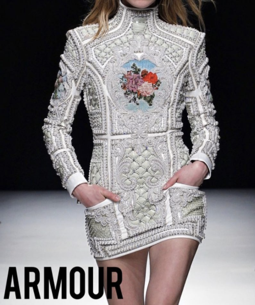 A style is described as armour-like when it possesses the qualities of protective clothing. As fashion itself is often considered armour, something to help survive the reality of everyday life, as the late  Bill Cunningham had said, designs such as 's are especially compelling when one is feeling particularly vulnerable. - Pictured: Balmain AW12