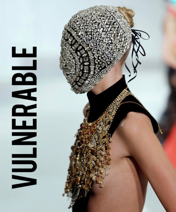 When we're vulnerable, we hide. Fear causes us to keep our authentic emotions hidden, and wear a mask to face the world as a means of protection. Few conceptual brands understand this as well as Maison Margiela, whose couture Artisanal collections take this notion literally and often show looks with masks. - Pictured: Maison Margiela Artisanal AW12