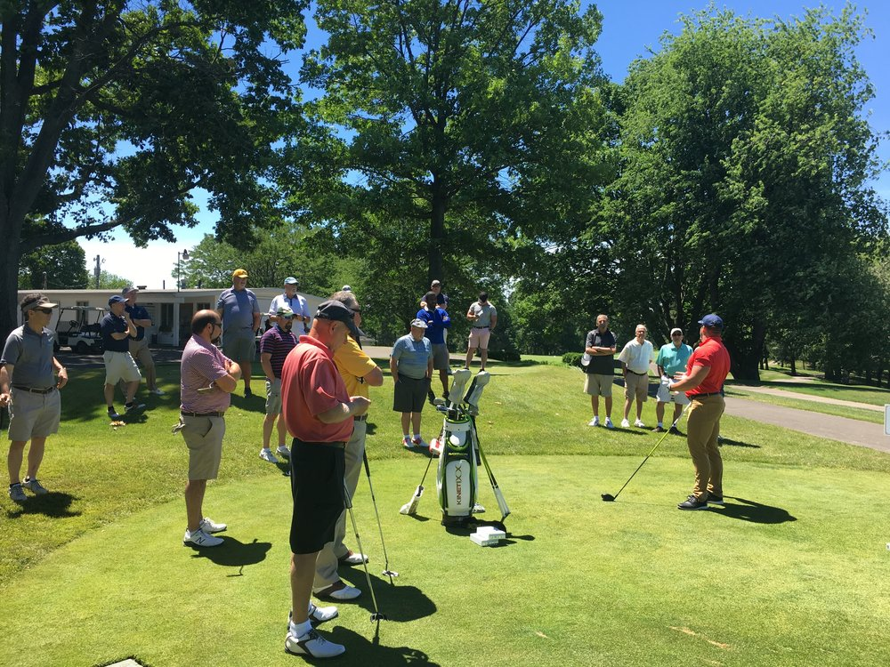 Ryan Steenberg talks to golfers during the long drive demonstration.