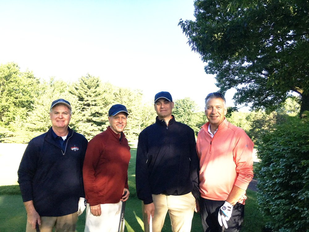 Eventual Champions from the Campus Construction Management Group get ready to tee off during the Bivona Corporate Golf Challenge.