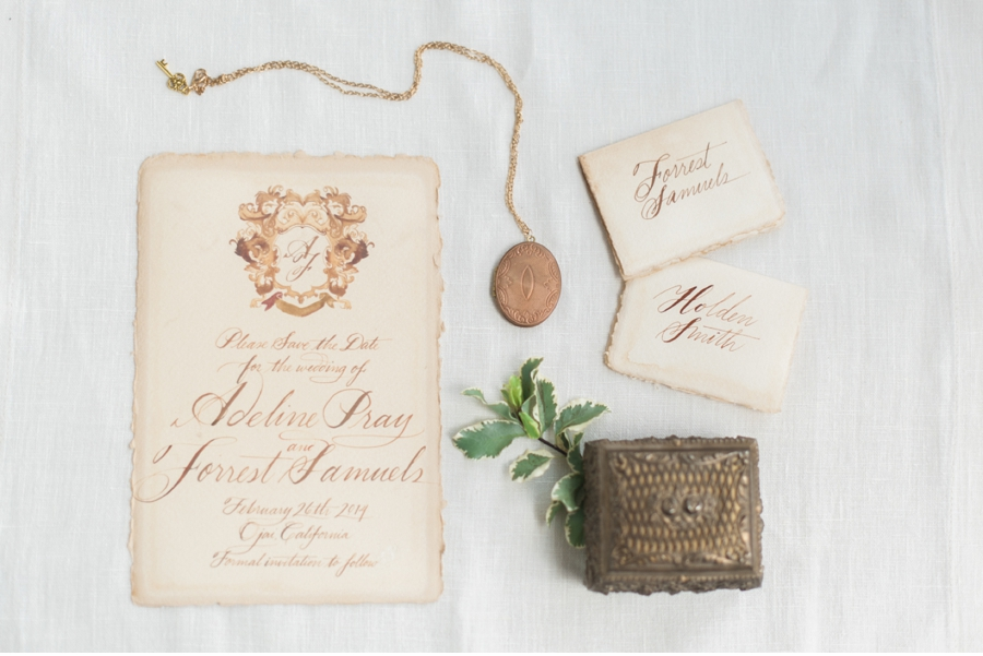 12. This wedding invitation topped with ornate crest brings some serious elegance to the party!  Calligraphy by   Julie Song Ink   and photography by   Vasia Photography   for the   Moda e Arte workshop  .  View the full feature on Vale + Vine   here  .