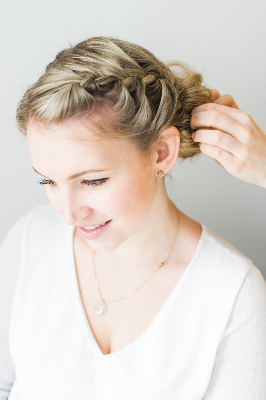 |STEP 5| Gently twist into a loose bun. You don't want to twist too tight as you want your bun to be loose, full and textured. Pin as necessary using bobby pins.