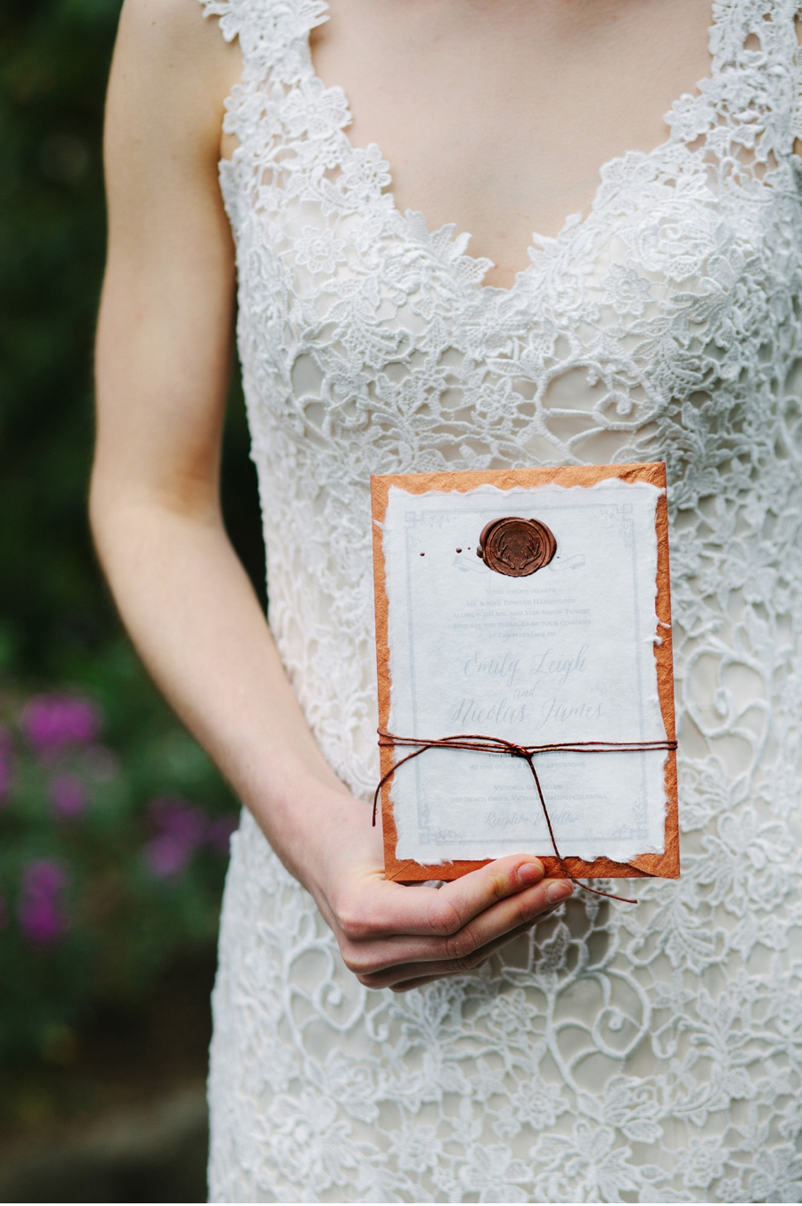 Bride-with-Handmade-Wedding-Invitation