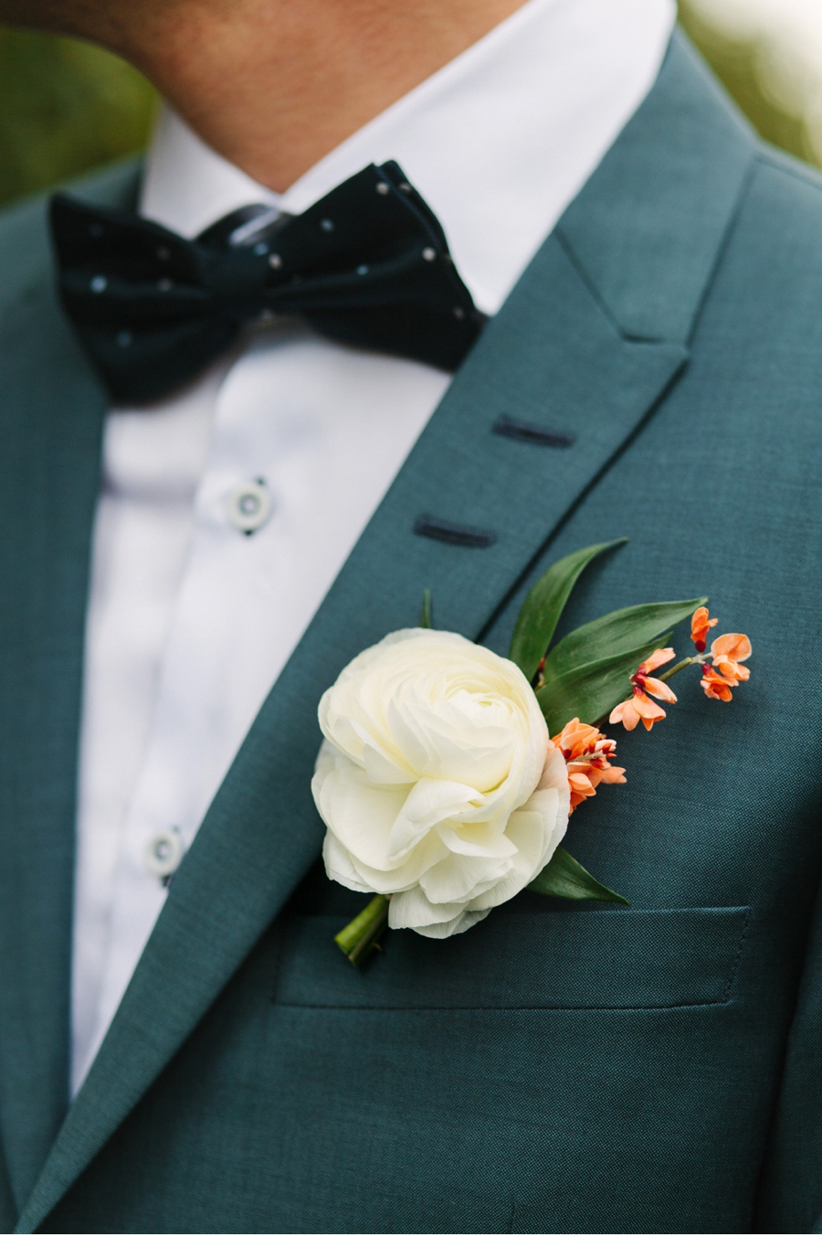 Grooms-Bowtie-and-Ranunculus-Boutinniere
