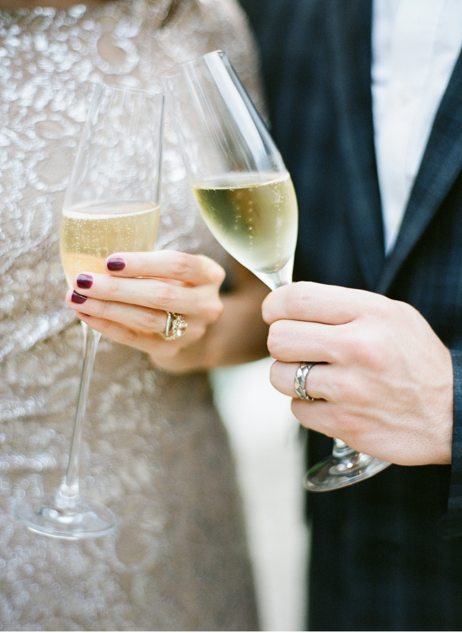 Bride-and-Groom-with-Champagne-and-Rings