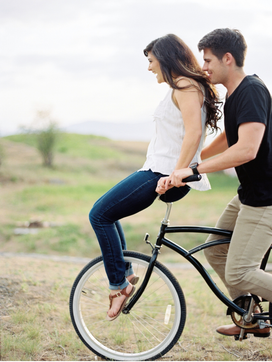 Engaged-Couple-on-Cruiser-Bike