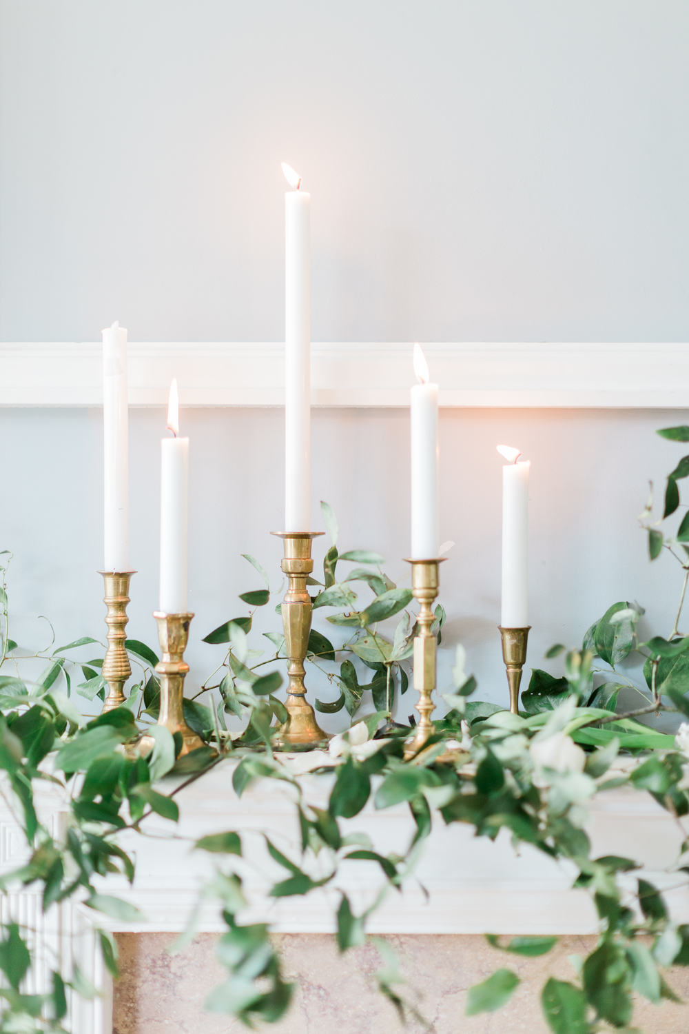 Candles-and-Greenery-on-Mantlepiece
