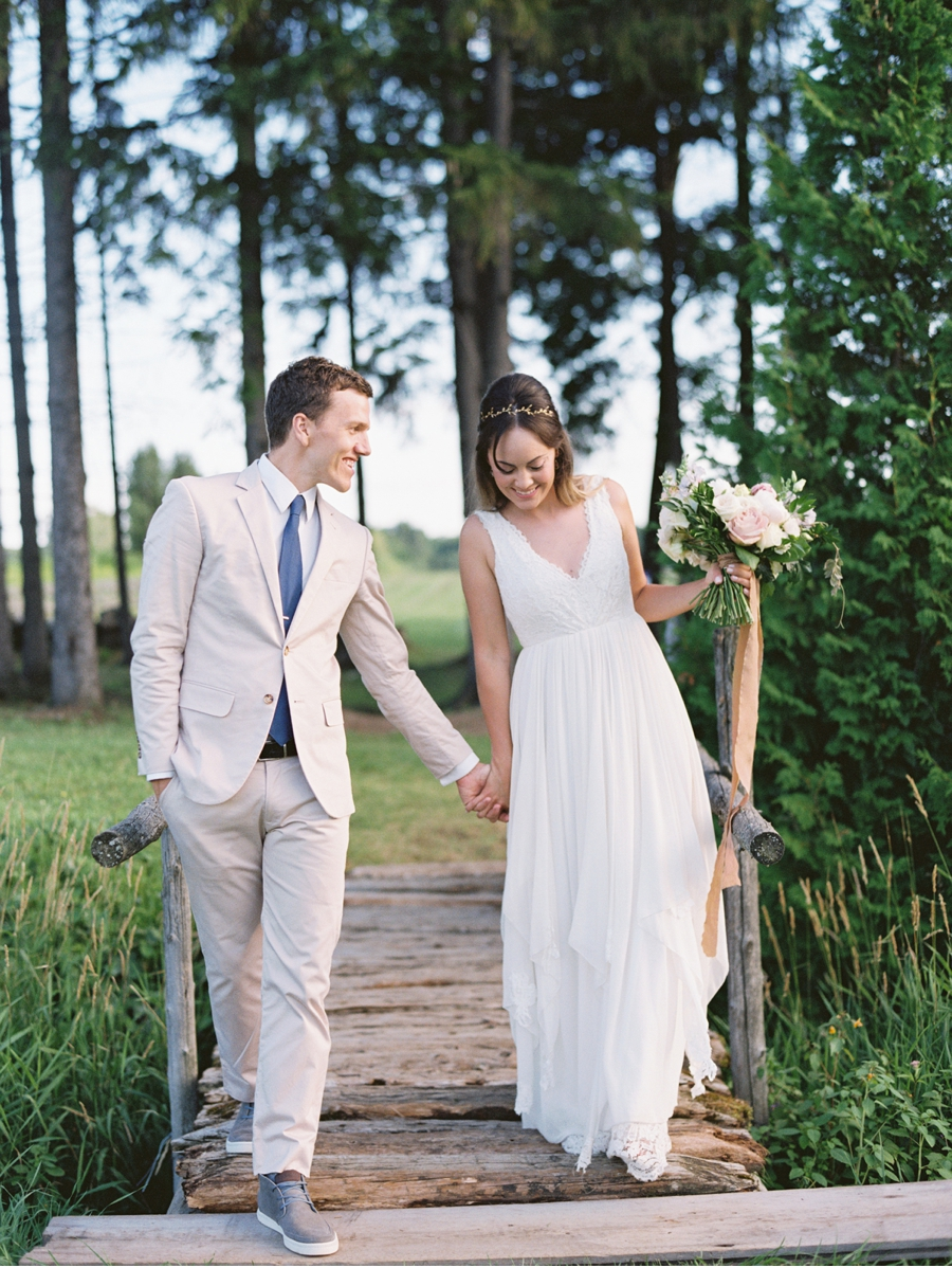 Bride-and-Groom-Crossing-a-Bridge