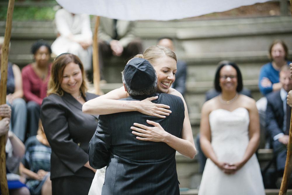 Rachel hugging her father during her wedding.