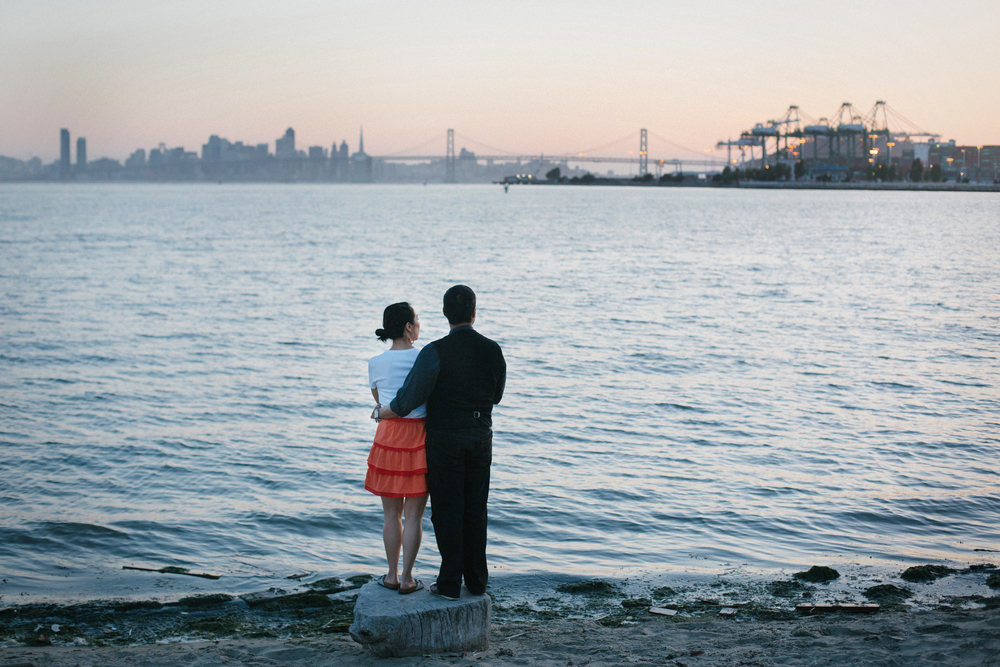 Sunset on San Francisco, the Oakland cranes and the Bay Bridge during Deb and Alfred's engagement shoot.