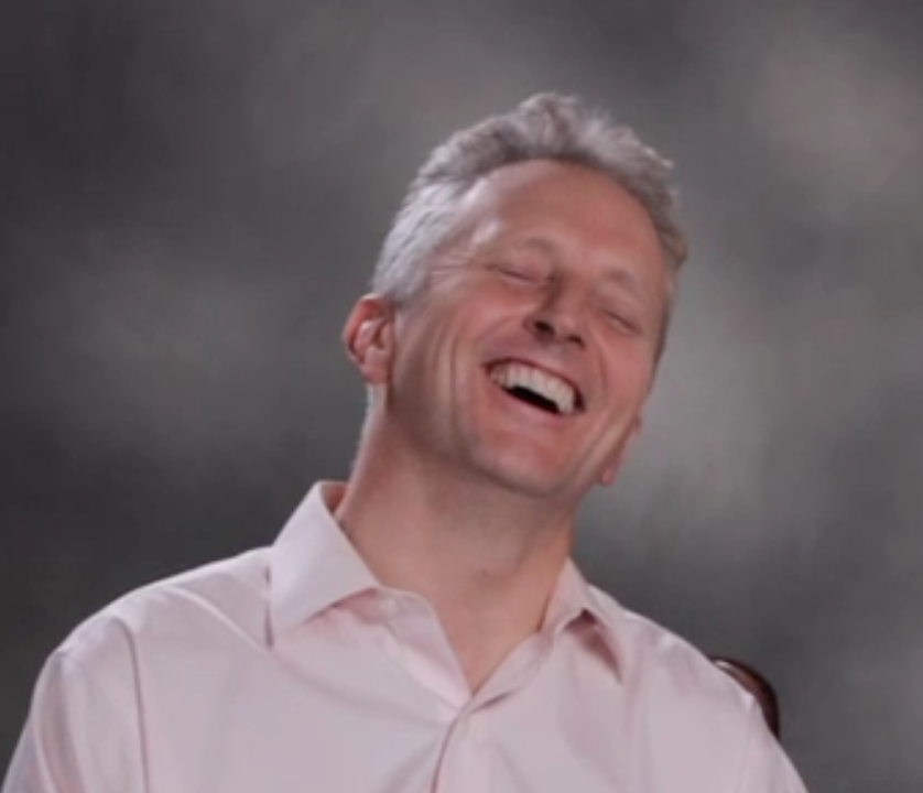 Jon Laughing Crop copy.png