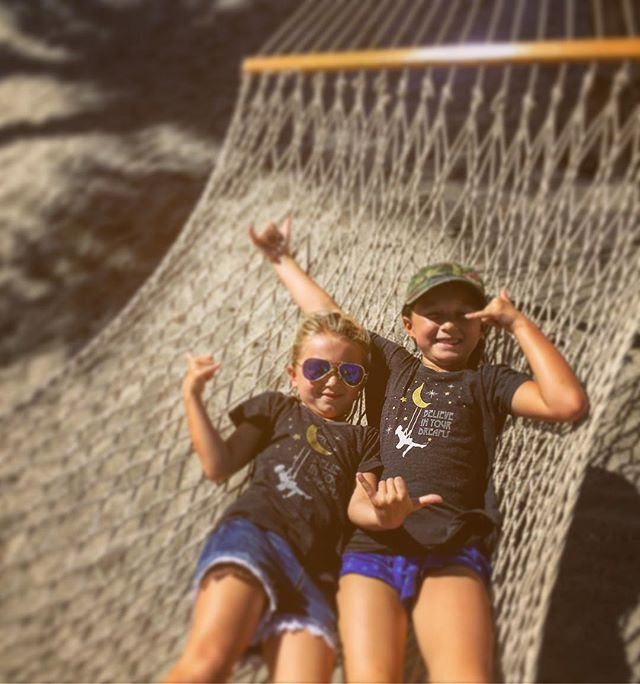 These two #wahines swinging in a hammock daydreaming - wearing our believe in your dreams kids tees 👯🤘🌈✨ #hammockgoals#daydreaming#hawaii#shaka#lifeisgood#believe#dreams#yourdivine#yourdivineapparel#kids#fashion#tees