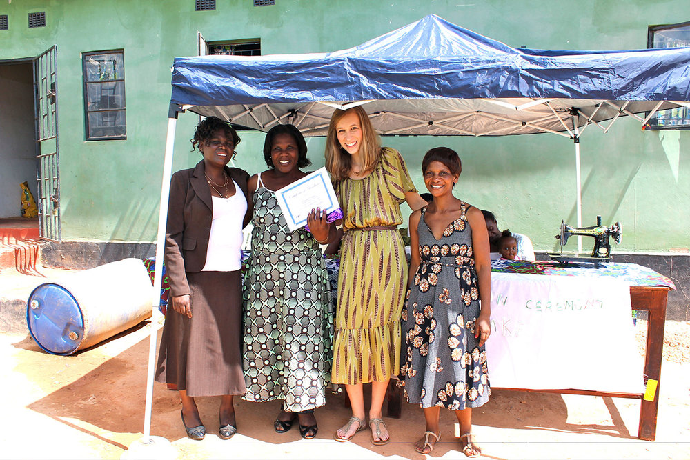 Left to right: Mrs. Mulenga (tailoring instructor), Charity (graduate), Amy (founder), Elina (Zambia Director) all pose together for a photo that will be cherished for many years to come.