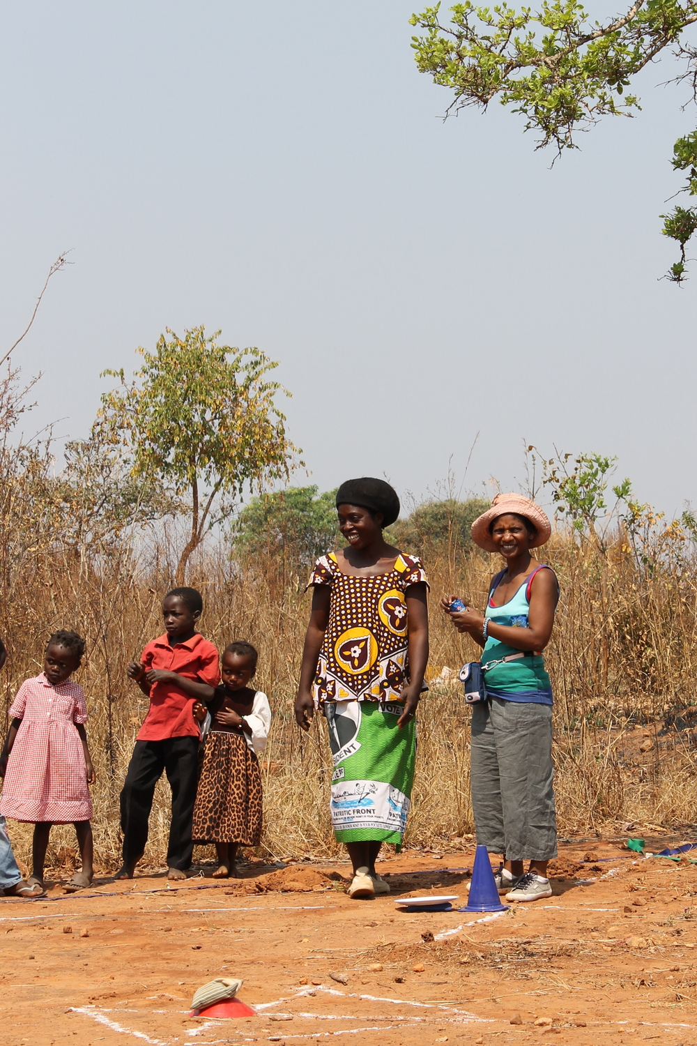 Elina (right) leading games for the children of Muchochoma Village during a past trip