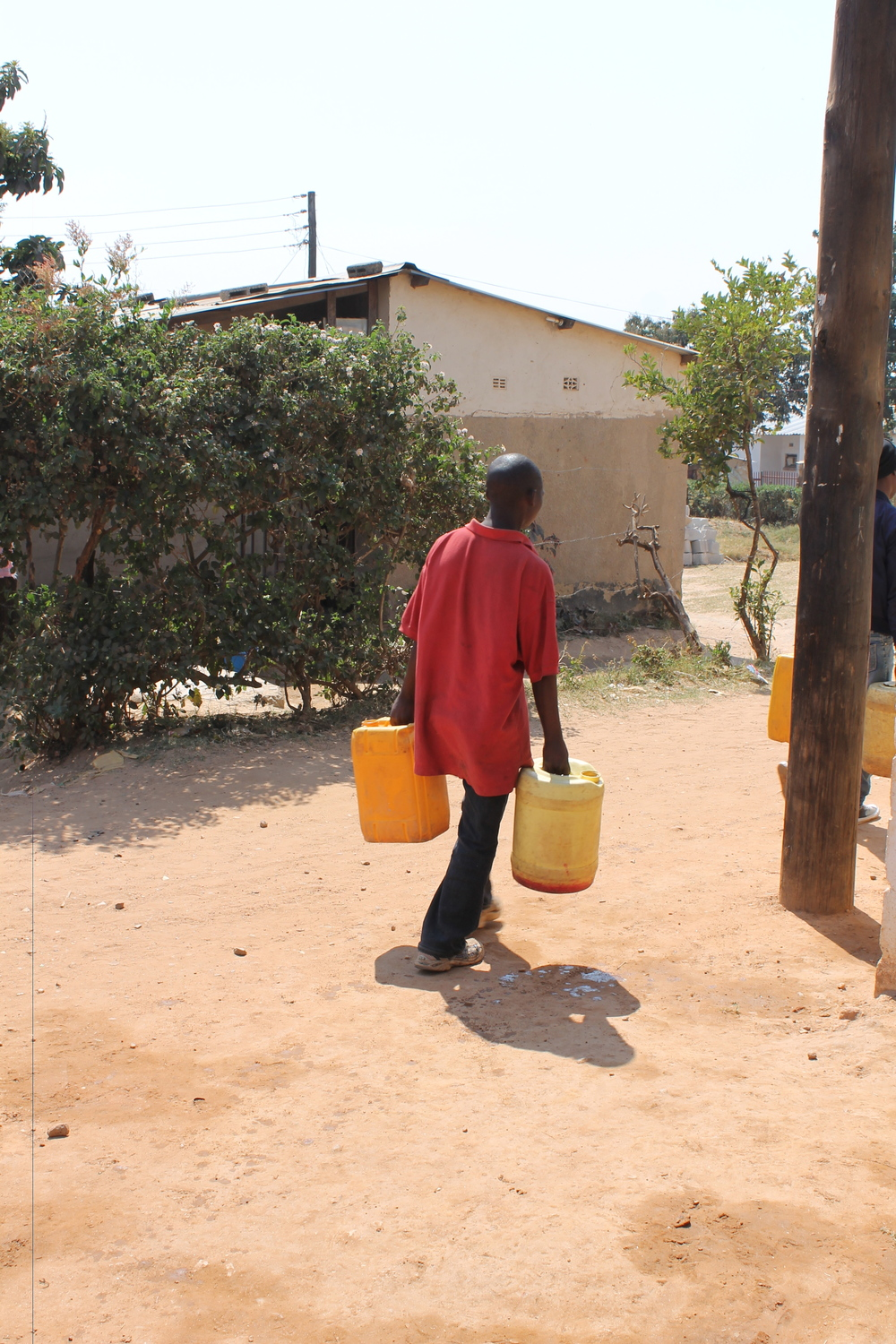 These water jugs mean life for households without running water. We love watching individuals walk away with full buckets, knowing the difference that water will make for entire families.