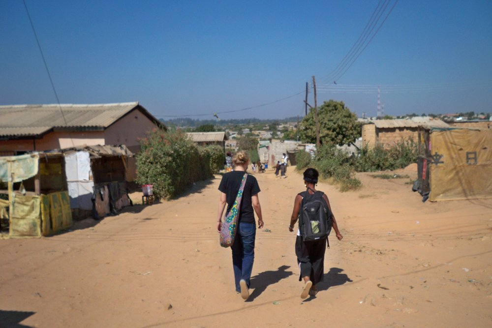 Amy and Elina walking through the Ng'ombe Compound in 2011 at the very beginning of Clothed in Hope.