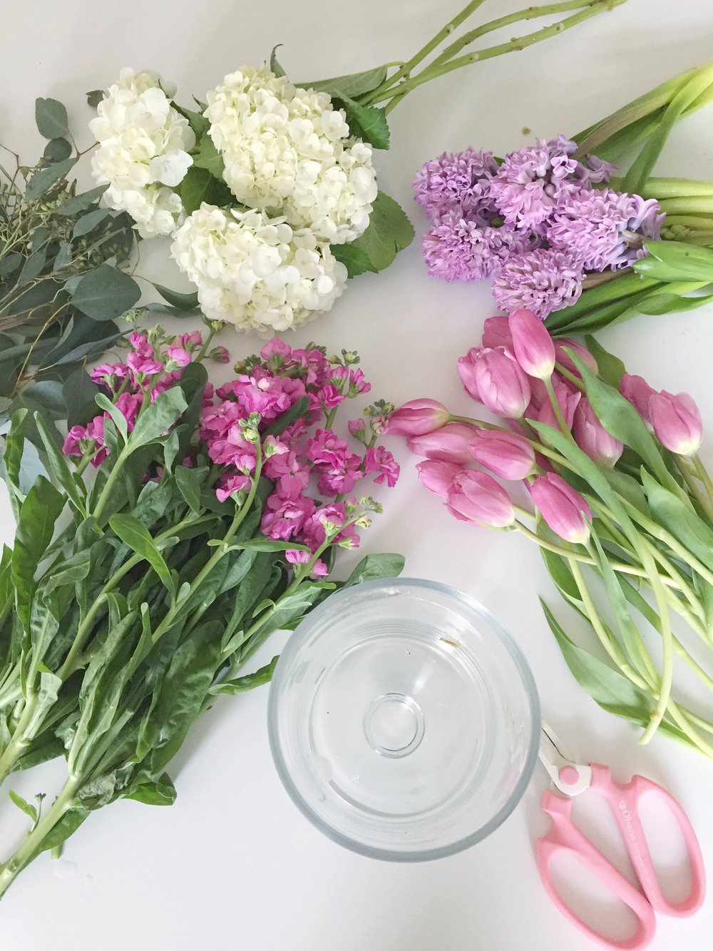 creating flower arrangements using grocery store flowers from Trader Joe's