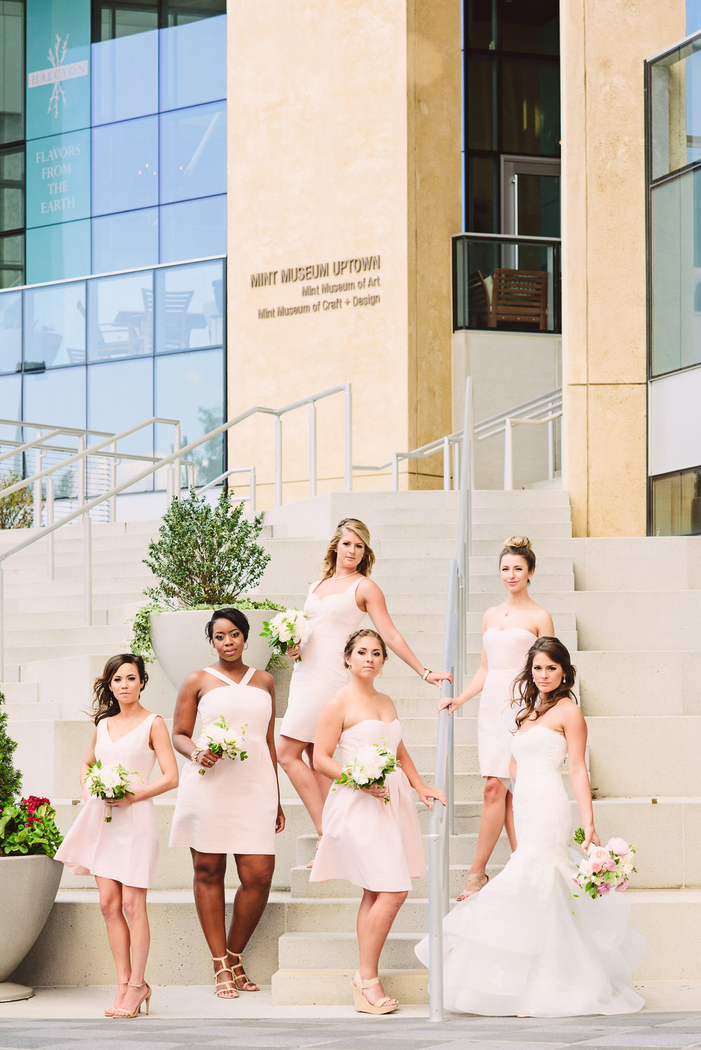 Bridal party style, Blush pink J Crew bridesmaid dresses, Monique Lhuillier lace wedding dress, Mint Museum Uptown wedding in Charlotte, North Carolina by The Graceful Host