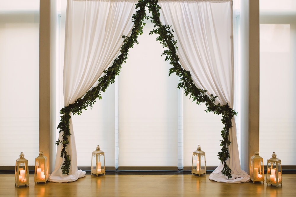 Wedding ceremony decoration, Wedding ceremony draping, Ceremony in the Mint Museum Atrium, Mint Museum Uptown wedding in Charlotte, North Carolina by The Graceful Host