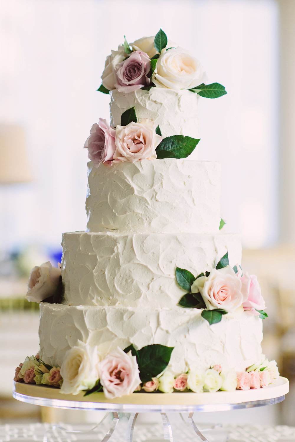 Textured wedding cake with rose and greenery clusters, Romantic wedding cake, Gorgeous wedding cake, Wow Factor Wedding Cakes, Monique Lhuillier wedding dress, Lace wedding dress, Bridal fashion, Wedding style, Wedding hair style, Bridal hair style, Half up half down hair style, Mint Museum Uptown wedding in Charlotte, North Carolina by The Graceful Host