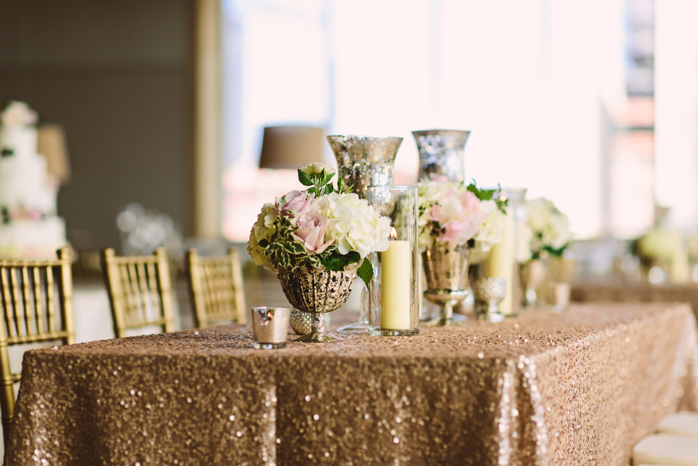 Blush sequin wedding linen, Wedding reception decor,  Wedding flowers, Candle centerpieces, Wedding centerpieces, Mint Museum Uptown wedding in Charlotte, North Carolina by The Graceful Host, Blush ivory and greenery wedding flowers