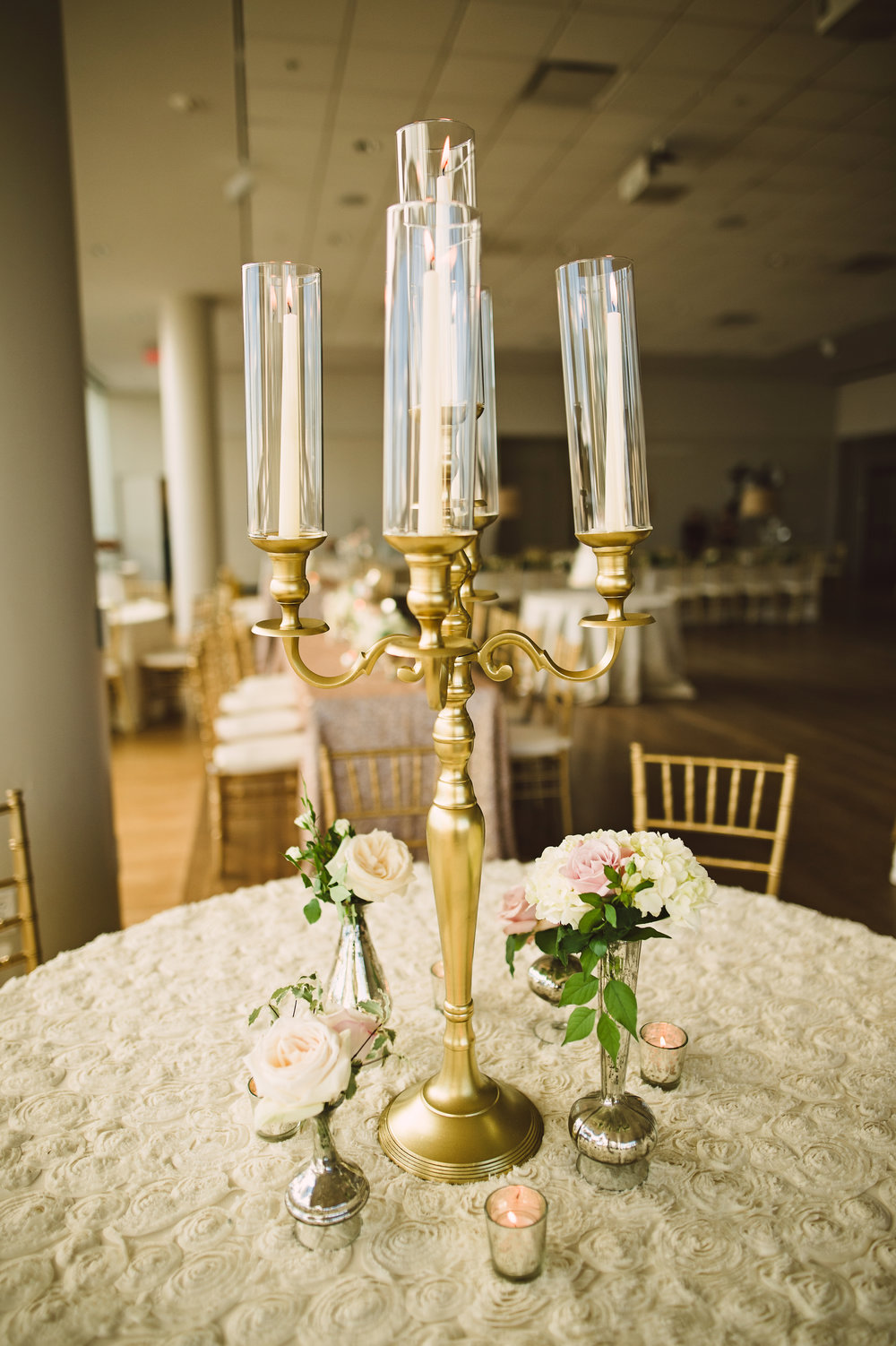 Candelabra centerpiece, Gold centerpieces, Wedding centerpieces, blush ivory and gold wedding, Candle wedding centerpieces, Tall wedding centerpieces, Blush sequin wedding linen, Wedding reception decor,  Wedding flowers, Candle centerpieces, Wedding centerpieces, Mint Museum Uptown wedding in Charlotte, North Carolina by The Graceful Host, Blush ivory and greenery wedding flowers