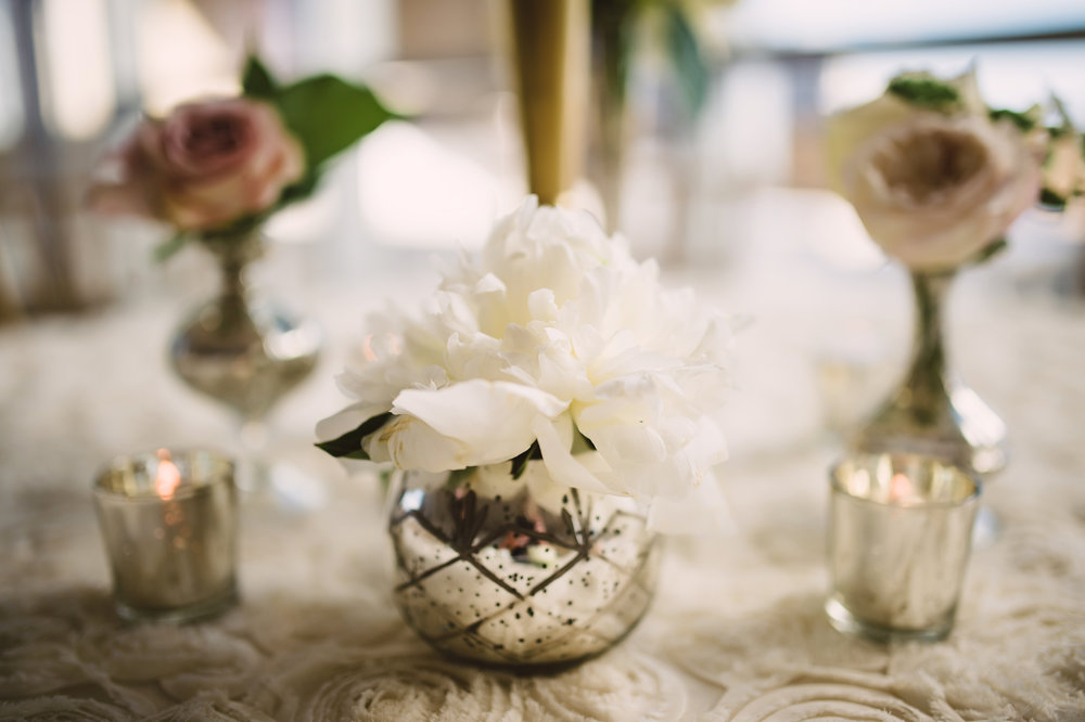Wedding reception decor,  Small wedding flower arrangements, Wedding flowers, Candle centerpieces, Wedding centerpieces, Mint Museum Uptown wedding in Charlotte, North Carolina by The Graceful Host, Blush ivory and greenery wedding flowers