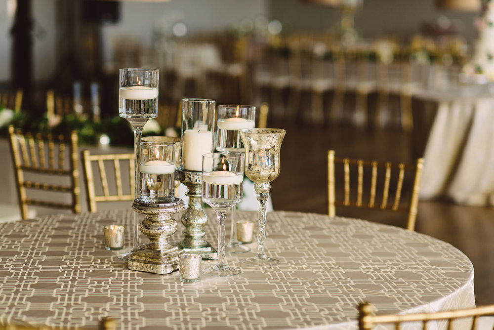 Candlelight centerpiece, Mercury glass wedding centerpieces, Candle wedding centerpieces, Wedding reception decorations, blush ivory and greenery wedding, Gold and ivory wedding inspiration, Mixed metals wedding centerpieces, Mint Museum Uptown wedding in Charlotte, North Carolina by The Graceful Host