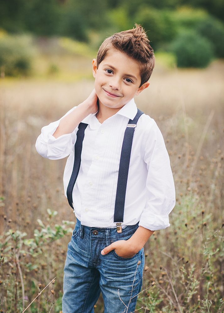 Boy wearing suspenders poses in folsom california field for amy wenzel photography