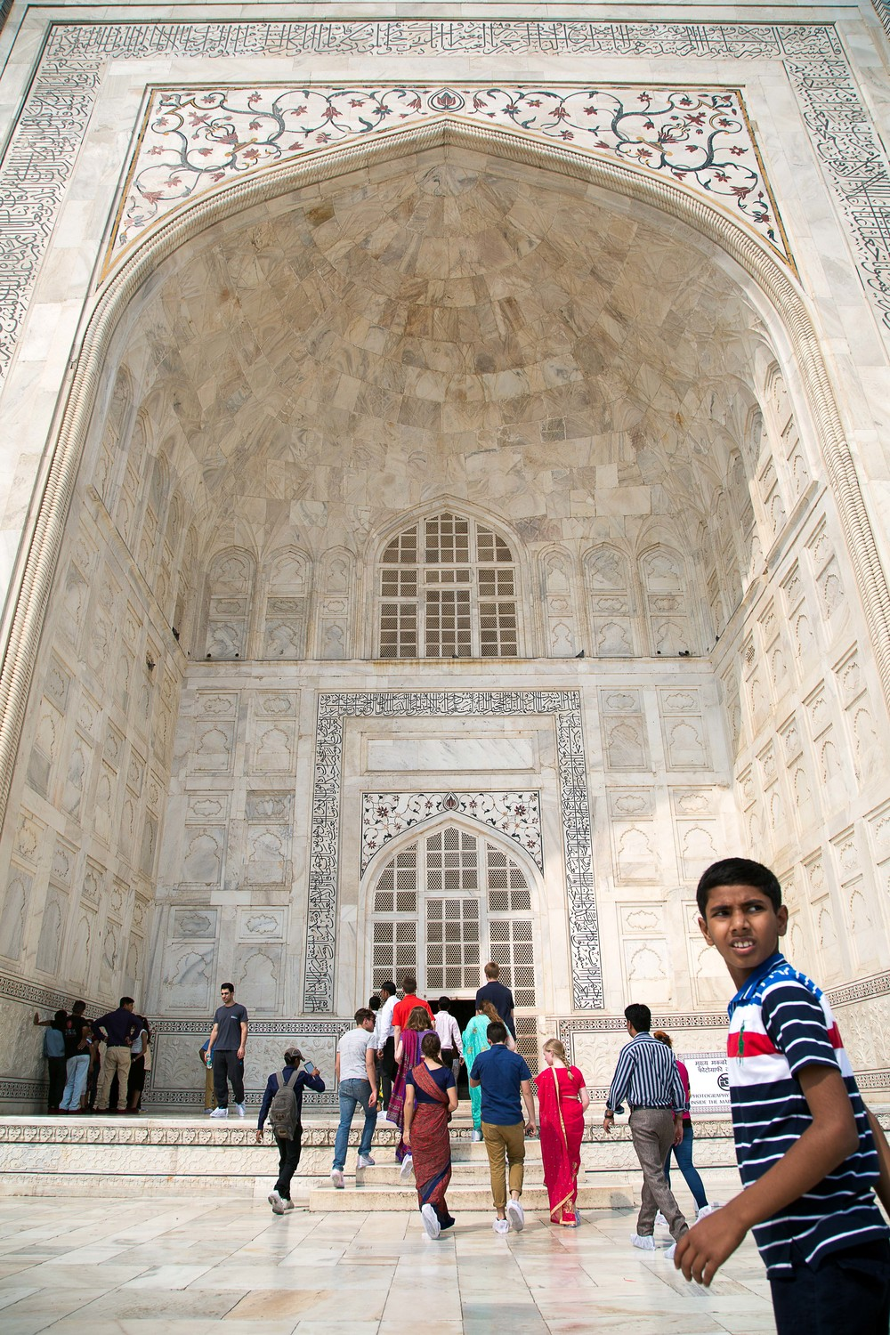 A boy looks back before entering the Taj Mahal in Agra, India.