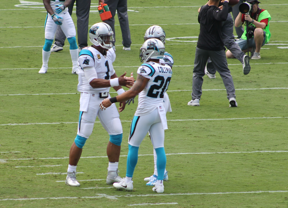 Cam Newton and Kurt Coleman