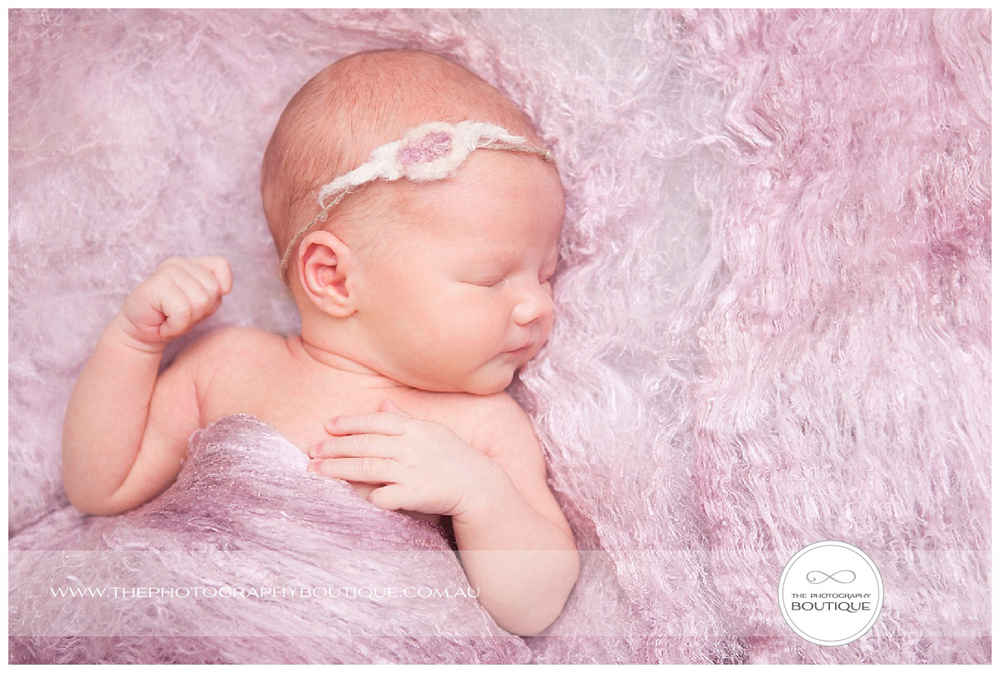 baby girl sleeping in pink wool wrap