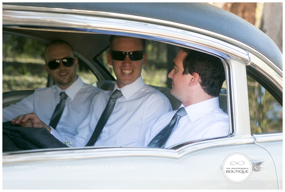 groom and best man in limo