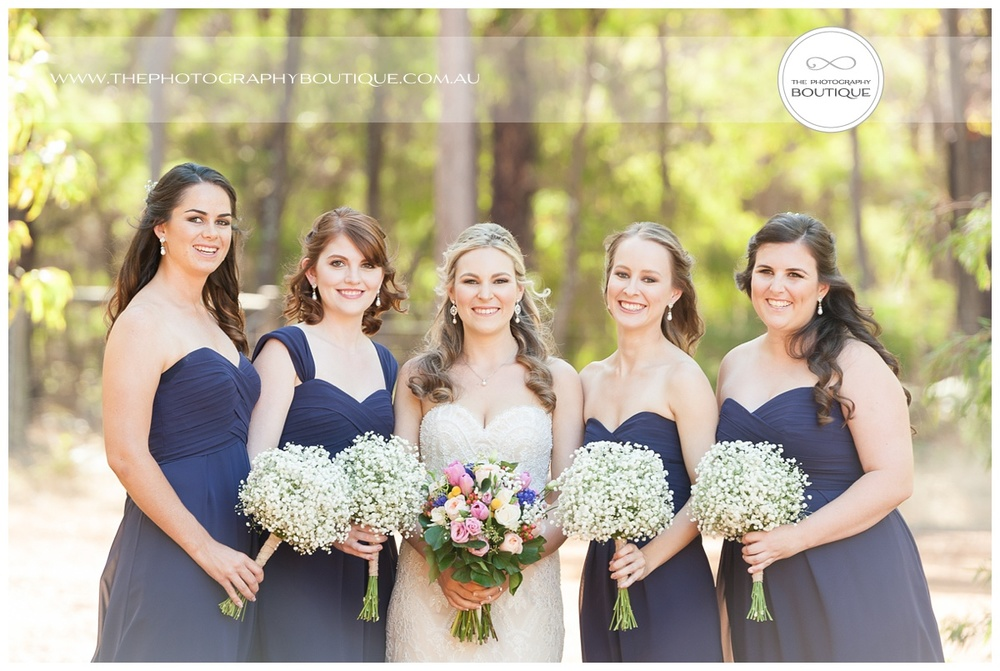 classic bride with bridesmaids pose at chandeliers on abbey margaret river