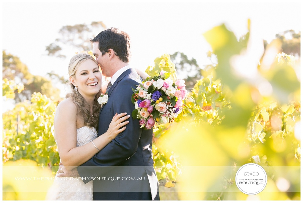 bride and groom in the vines at Windows Estate Margaret River