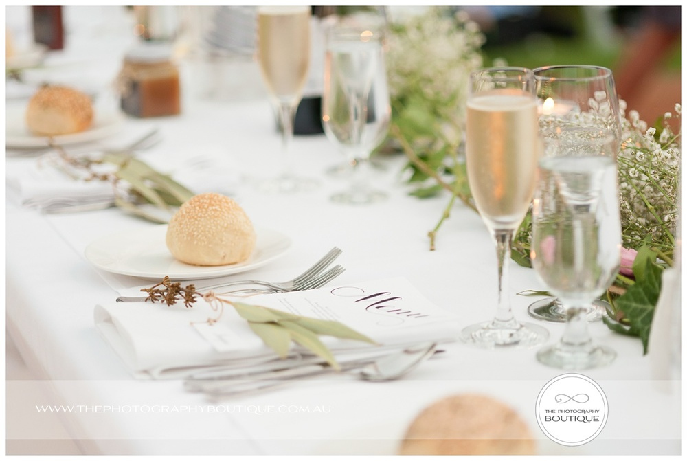 wedding reception natural table styling with leaves and hessian
