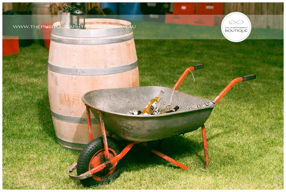 wedding beer bottles in a wheel barrow
