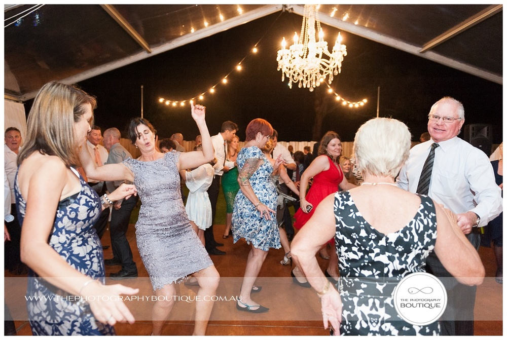 funny guest dancing at wedding reception
