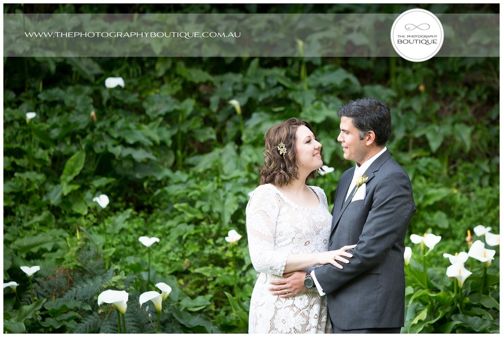 Bride and groom in the garden at Caves House Yallingup