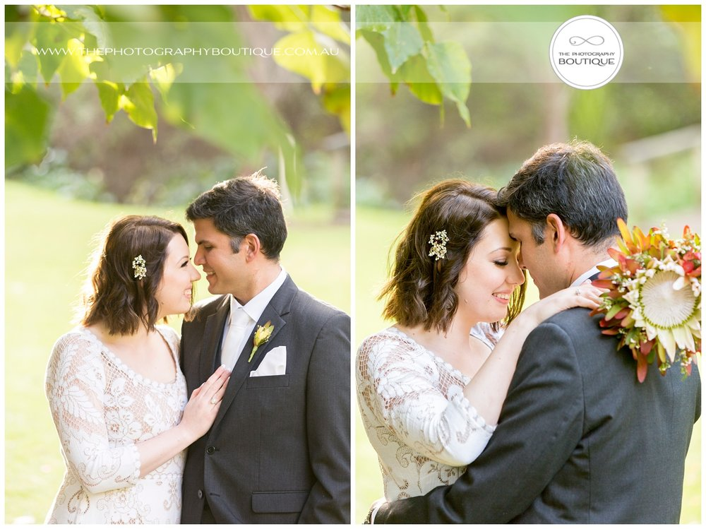 bride and groom cuddling under a tree at Caves House Yallingup